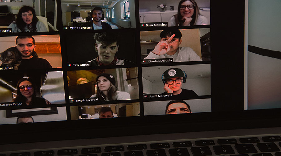 Screen showing lots of people in a conference call