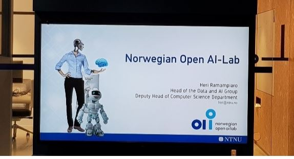 Colour photograph of presentation slide for Norwegian Open AI-Lab