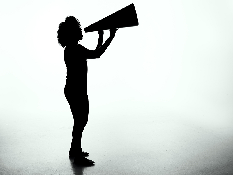silhouette of a woman holding a megaphone