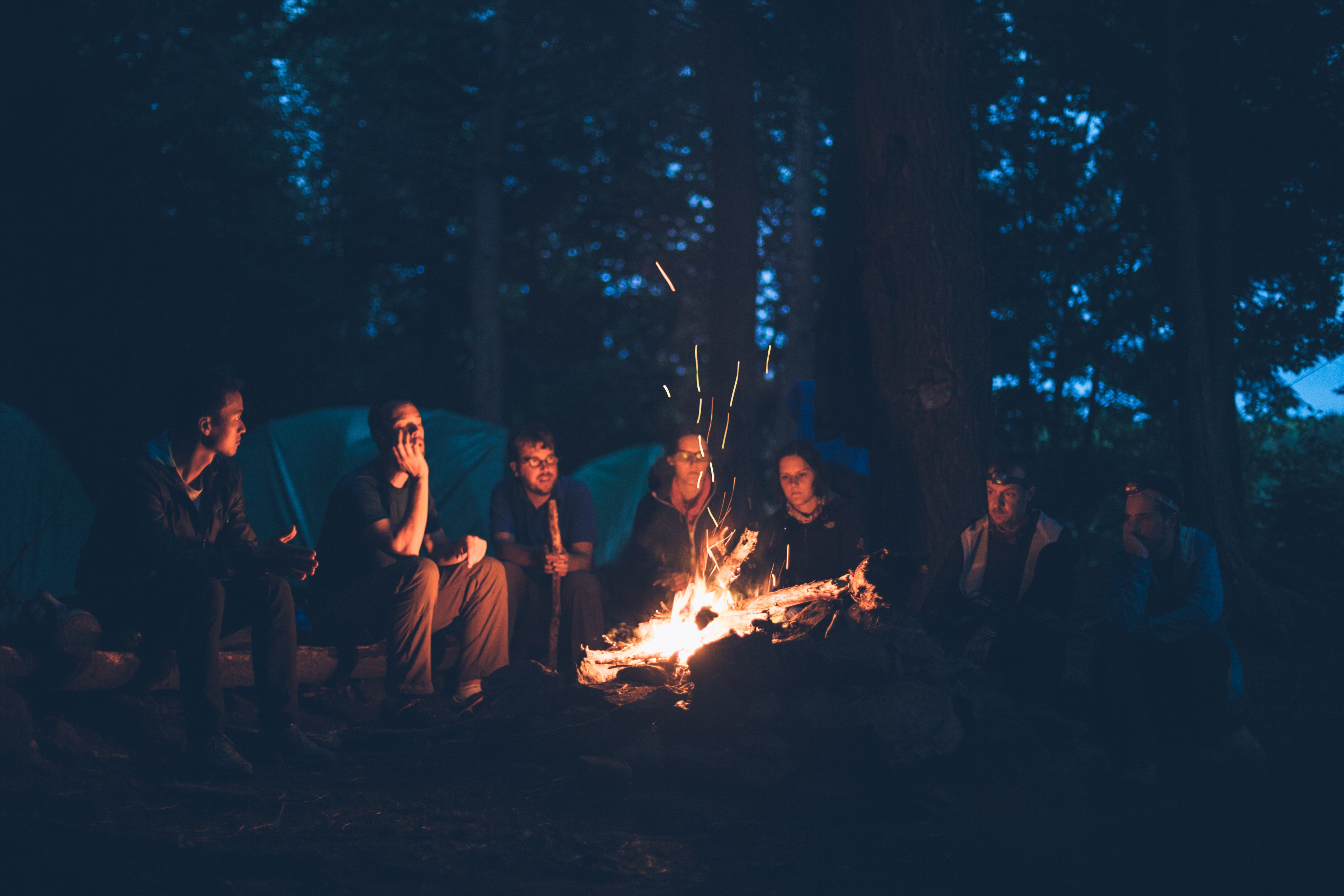 people around a camp fire