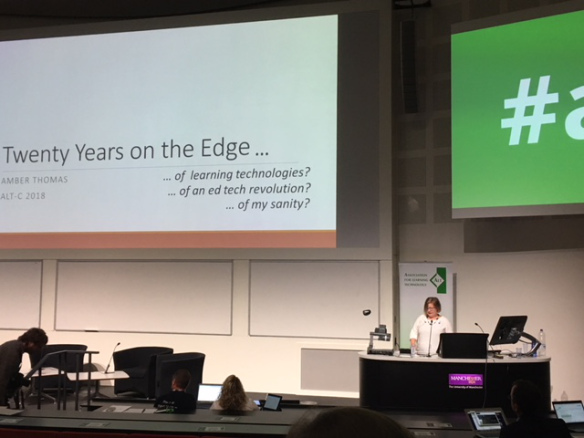 Colour photograph of Amber Thomas presenting at ALTC on her twenty years on the edge