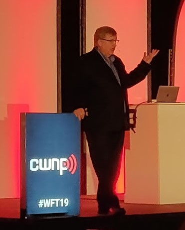 Colour photograph of Keith R Parson presenting on stage at Wi-Fi Trek 2019