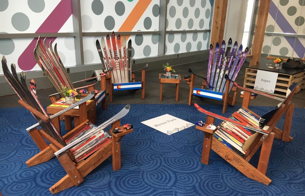 Photograph of chairs made of multi-colour skis at Educause 2019